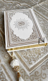 Quran with gilding in arabic